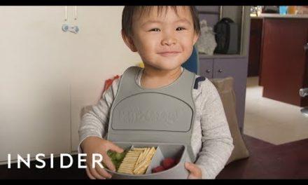 Travel Bib Has Three Compartments To Hold Kids' Snacks