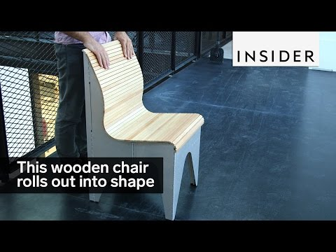 This wooden chair rolls out into shape